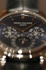 """A Patek Philippe logo is seen on the """"Calendrier Perpetuel 5140P"""" watch displayed on the watchmaker's showcase at the Baselworld in Basel"""