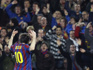 Barcelona's Messi celebrates after scoring against Arsenal during their Champions League quarter-final soccer match in Barcelona