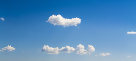 White clouds in blue summer sky