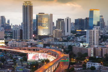 City downtown business office building aerial view with highway intersection, Bangkok cityscape Thailand