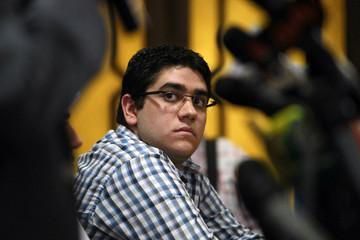 Abdallah Mohamed Mursi, son of Egypt's ousted president Mohamed Mursi, addresses a news conference in Cairo