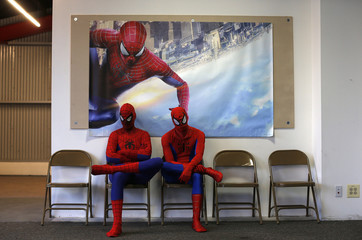 "Applicants dressed up as fictional comic book superhero Spider-Man wait for their turn to audition to be a part of a promotional campaign for the upcoming release of ""The Amazing Spider-Man 2"" in Chicago"