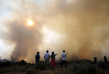 People watch as the Beaver Creek wildfire rages outside Hailey