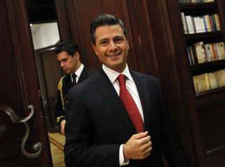 Mexico's President Enrique Pena Nieto arrives for an interview with Reuters at the presidential palace in Mexico City