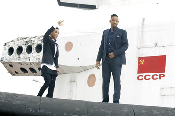 """U.S. actor Will Smith and his son Jaden Smith pose during a photo call to promote """"After Earth"""" on the mainplane of the Buran space shuttle in Moscow"""