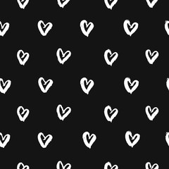 Seamless pattern with hand drawn white hearts. Cute black and white background. Vector illustration.