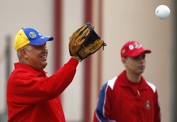 Venezuela's President Hugo Chavez plays softball before a press conference at Miraflores Palace in Caracas