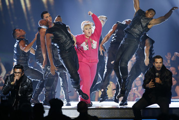 Host Rebel Wilson opens the show at the 2013 MTV Movie Awards in Culver City, California