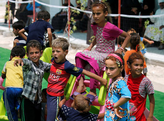 Displaced Iraqi children, who fled from Falluja because of Islamic State violence, play at a refugee camp in Ameriyat Falluja, south of Falluja