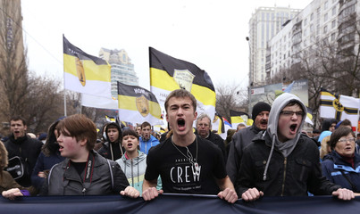 """People attend a """"Russian March"""" demonstration, organized by the """"Russian Coalition of Action"""" movement, on National Unity Day in Moscow"""