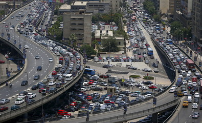 General view shows a traffic jam at the 6th October bridge and Ramses Street in downtown Cairo