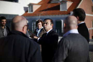 Ghosn, chairman and chief executive officer of French carmaker Renault, speaks with journalist during a meeting to promote the new electric car Renault Zoe in Lisbon