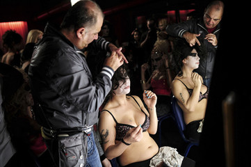 A participant gets ready backstage for the country's first ever transgender/transsexual fashion show in Istanbul