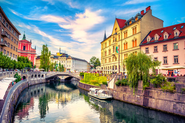 Cityscape view on Ljubljanica river canal in Ljubljana old town. Ljubljana is the capital of Slovenia and famous european tourist destination. Wall mural