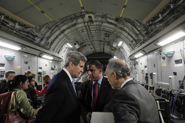 U.S. Secretary of State Kerry speaks with Talwar and another advisor on an Air Force C-17 aircraft upon his return to Amman from a trip to Baghdad