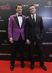 Host of MSNBC Live Roberts and his husband Abner arrive for the Miss Universe pageant at the Crocus City Hall in Moscow
