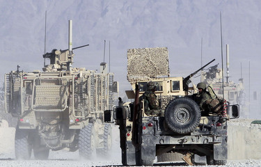U.S. soldiers from 549th MP Company, Task Force Bronco, aboard armoured vehicles leave a U.S. base as they embark on a joint mission with Afghan soldiers at Forward Operating Base Connolly in Nangarhar province