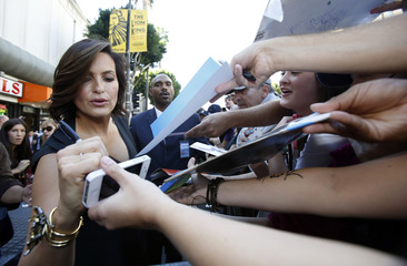 Hargitay signs autographs after unveiling her star on the Walk of Fame in Hollywood