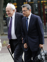 Former Goldman Sachs Group Inc board member Gupta and lawyer Naftalis arrive at Manhattan Federal Court in New York