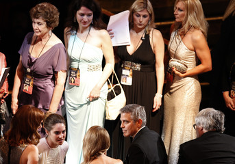 Clooney sits in the seats at the 84th Academy Awards in Hollywood