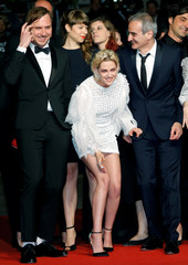 """Director Olivier Assayas and cast members Lars Eidinger and Kristen Stewart pose on red carpet as they arrive for the screening of the film """"Personal Shopper"""" in competition at the 69th Cannes Film Festival in Cannes"""