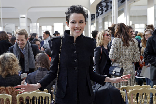 Actress Loan Chabanol poses before attending the Chanel Fall/Winter 2016/2017 women's ready-to-wear collection show in Paris