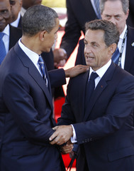 U.S. President Obama says goodbye to France's President Sarkozy at the end of the G8 summit meeting in Deauvill