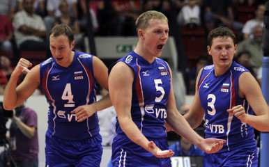 Russia's Khtey, Grankin and Apalikov react during their Men's Volleyball European Championship Group B preliminary match against Portugal in Karlovy Vary