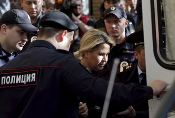 Former head of Russian Defence Ministry's Property Relations Department Vasilyeva is escorted after court hearing in Moscow