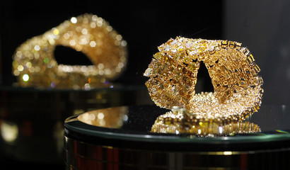 Gold jewellery are pictured on stand at Valenza international jewels exposition in Valenza