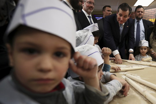 U.S. Republican presidential candidate Ted Cruz speaks to children after making matzah at a campaign event in the Brooklyn borough of New York
