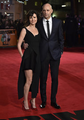 """British actor Strong and his wife Marshall pose at the world premiere of the film """"Grimsby"""" at Leicester Square in London"""