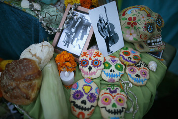 An altar is decorated with candy skulls during the 14th annual Dia de los Muertos festival at Hollywood Forever Cemetery in Los Angeles