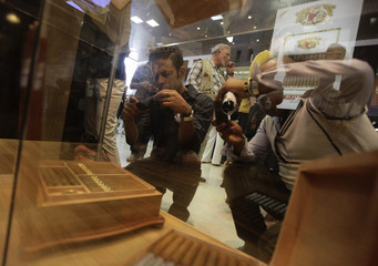 Visitors take pictures of cigars on display at the XIV Havana Cigar Festival in Havana