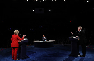 Republican U.S. presidential nominee Donald Trump and Democratic U.S. presidential nominee Hillary Clinton discuss a point during their first presidential debate at Hofstra University in Hempstead