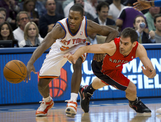 Toronto Raptors guard Calderon loses the ball to New York Knicks guard Douglas in their NBA basketball game at Madison Square Garden in New York