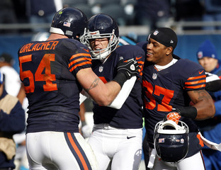 Chicago Bears middle linebacker Urlacher and free safety Walters celebrate with kicker Gould after he kicked the game winning field goal against the Carolina Panthers during their NFL football game in Chicago