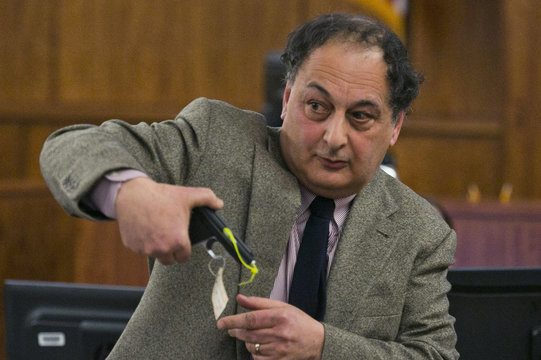 Attorney James Sultan shows a .22 caliber gun during the murder trial of former NFL player Aaron Hernandez at the Bristol County Superior Court in Fall River