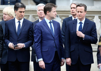 Ed Miliband (L) who today resigned as leader of the Labour Party, Nick Clegg who today resigned as leader of the Liberal Democrats (C), and Britain's Prime Minister David Cameron (R) pay tribute at the Cenotaph to mark the 70th anniversary of VE Day in Lo