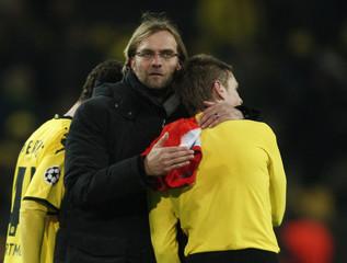 Borussia Dortmund's coach Klopp hugs Piszczek after their Group F Champions League soccer match against Olympique Marseille in Dortmund
