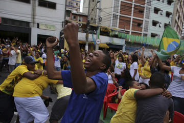 Brazilian soccer fans celebrate their victory at Bixiga neighbourhood at center of the city of Sao Paulo at the end of the 2014 World Cup round of 16 soccer match between Brazil and Chile in Belo Horizonte