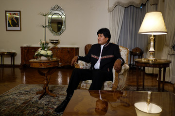 Bolivia's President Evo Morales speaks during an interview with journalists at the presidential residence in La Paz