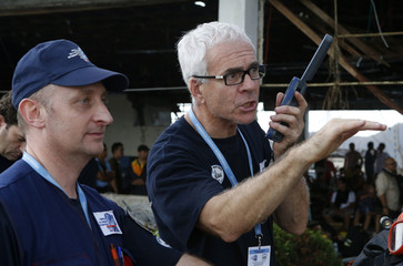 French relief aid workers arrive at the airport to help victims of Typhoon Haiyan, in Tacloban city in central Philippines