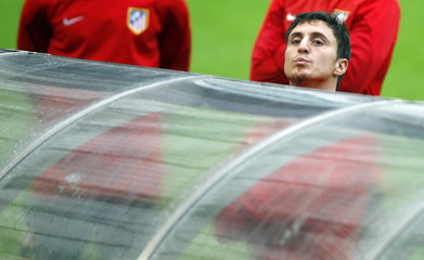 Atletico Madrid's Cristian Rodriguez looks over the bench prior to the training session at Dragon stadium in Porto
