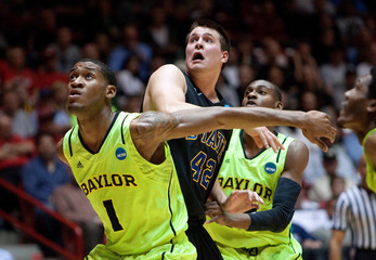 South Dakota State University's Jordan Dykstra battles for a rebound against Baylor University's Perry Jones III and Deuce Bello during their men's NCAA basketball game in Albuquerque