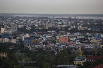 Shwedagon pagoda seen among the building in Yangon city
