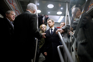 France's President Sarkozy and France's Ecology, Sustainable Development, Transport and Housing Minister Kosciusko-Morizet visit a suburban train station in La Defense near Paris
