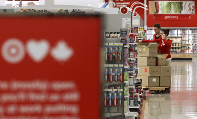 Employees stock shelves at the new Target store in Guelph, Ontario