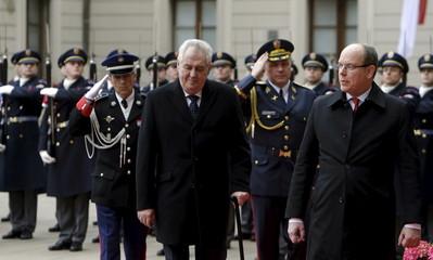 Czech Republic's President Zeman and Monaco's Prince Albert II walk past the guard of honour at Prague Castle in Prague