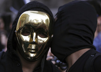 Members of the Black Bloc Egypt group take part in a protest rally against Egyptian President Mohamed Mursi and members of the Muslim Brotherhood in Cairo